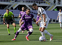 Cristiano Ronaldo of Juventus Martin Caceres of Fiorentina during the  italian serie a soccer match,Fiorentina - Juventus at  theStadio Franchi in  Florence Italy ,