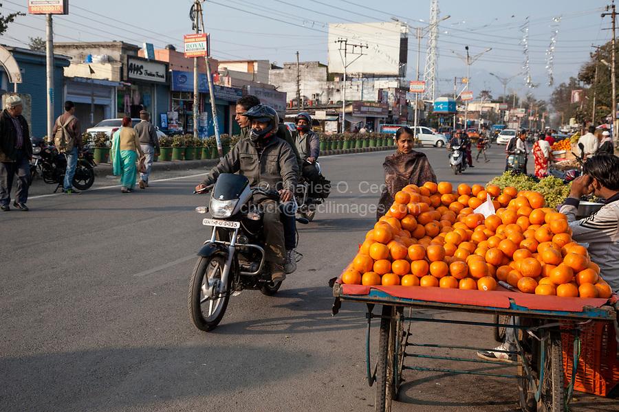 India, Dehradun.  Street Scene with Orange Vendor.