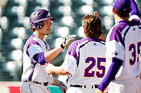 Kyle Pollock (5) of the Evansville Purple Aces is congratulated by teammates after hitting a home run during a game against the Indiana State Sycamores in the 2012 Missouri Valley Conference Championship Tournament at Hammons Field on May 23, 2012 in Springfield, Missouri. (David Welker/Four Seam Images)