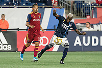 FOXBOROUGH, MA - SEPTEMBER 21: Luis Caicedo #27 of New England Revolution kicks the ball away from Sebastian Saucedo #23 of Real Salt Lake during a game between Real Salt Lake and New England Revolution at Gillette Stadium on September 21, 2019 in Foxborough, Massachusetts.