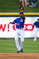 Round Rock Express shortstop Luis Sardinas (15) snares a line drive during the first game of a Pacific Coast League doubleheader against the Memphis Redbirds on August 3, 2014 at the Dell Diamond in Round Rock, Texas. The Redbirds defeated the Express 4-0. (Andrew Woolley/Four Seam Images)