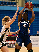 Janice Monakana of Sevenoaks Suns looks for the pass during the WBBL Championship match between Sevenoaks Suns and Newcastle Eagles at Surrey Sports Park, Guildford, England on 20 March 2021. Photo by Liam McAvoy
