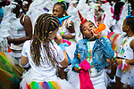 © Joel Goodman - 07973 332324 . 12/08/2017 . Manchester , UK . The annual Caribbean Carnival J'Ouvert Parade through Moss Side in South Manchester . The 2017 theme is Bacchanal . There is concern in the community following the stabbing to death of Sait Mboob during a mass fight which saw several seriously hurt on Tuesday night (8th August 2017) . Photo credit : Joel Goodman