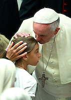 Papa Francesco bacia una bambina durante l'udienza generale del mercoledi' in Aula Paolo VI, Citta' del Vaticano, 6 agosto 2014.<br /> Pope Francis kisses a child during his weekly general audience in the Paul VI hall at the Vatican, 6 August 2014.<br /> UPDATE IMAGES PRESS/Isabella Bonotto<br /> <br /> STRICTLY ONLY FOR EDITORIAL USE