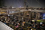 NEW YORK, NY — SEPTEMBER 25, 2020:  Demonstrators sit on the roadway of the Brooklyn Bridge during a protest against a Kentucky Grand Jury decision to not directly indict the officers involved in the shooting of Breonna Taylor, a 26 year-old EMT who was killed in her Louisville home by police on March 13th of this year, on September 25, 2020 in New York City.  Former police detective Brett Hankison faces three felony charges of wanton endangerment.  Photograph by Michael Nagle