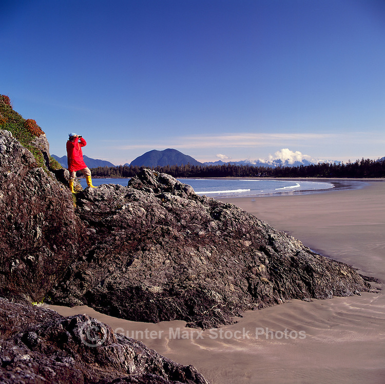 Hiker hiking on Rocks at Chesterman Beach, near Tofino and Pacific Rim National Park Reserve, on West Coast of Vancouver Island, BC, British Columbia, Canada (Model Released)