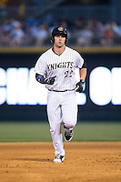 Matt Davidson (22) of the Charlotte Knights rounds the bases after hitting a home run against the Norfolk Tides at BB&T BallPark on April 9, 2015 in Charlotte, North Carolina.  The Knights defeated the Tides 6-3.   (Brian Westerholt/Four Seam Images)