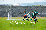 Tralee Dynamos Brendan Meehan bears down on the Fenit Samphires goals as keeper Jack Dwyer and defenders Conor McGirney andJack Mccarthy back track to assist in the U14 cup competition.