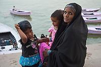 Muslim women and children at the River Ganges Varanasi India