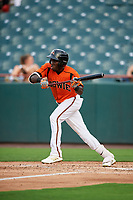 Bowie Baysox center fielder Anderson Feliz (20) squares around to bunt during the first game of a doubleheader against the Trenton Thunder on June 13, 2018 at Prince George's Stadium in Bowie, Maryland.  Trenton defeated Bowie 4-3.  (Mike Janes/Four Seam Images)