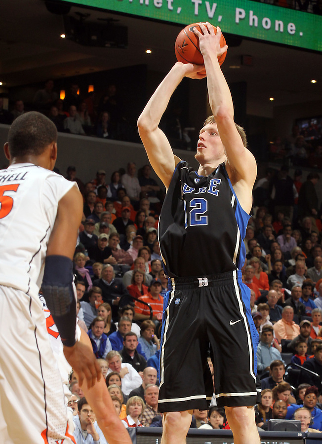 Feb. 16, 2011; Charlottesville, VA, USA; Duke Blue Devils forward Kyle Singler (12) shoots over Virginia Cavaliers forward Akil Mitchell (25) during the first half of the game at the John Paul Jones Arena.  Credit Image: © Andrew Shurtleff