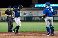 Lakeland Flying Tigers Andrew Navigato (58) crosses home plate after hitting a home with umpire Kenny Jackson and catcher Ryan Sloniger (24) looking on during a game against the Dunedin Blue Jays on June 8, 2021 at Joker Marchant Stadium in Lakeland, Florida.  (Mike Janes/Four Seam Images)