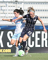 Becky Sauerbrunn #22 of the Washington Freedom gets the ball away from Karen Carney #14 of the Chicago Red Stars during a WPS match on July 4 2010 at the Maryland Soccerplex, in Boyds, Maryland. The match ended in a 0-0 tie.