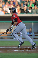 Birmingham Barons center fielder Trayce Thompson #24 swings at a pitch during game three of the Southern League Northern Division Championship Series against the Tennessee Smokies at Smokies Park on September 7, 2013 in Kodak, Tennessee. The Smokies won the game 9-2. (Tony Farlow/Four Seam Images)