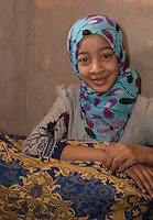 Morocco.  Young Amazigh Berber Girl Ait Benhaddou Ksar, a World Heritage Site.