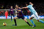 Sergio Busquets Burgos of FC Barcelona (L) is tackled by Nestor Alejandro Araujo Razo of RC Celta de Vigo during the La Liga 2018-19 match between FC Barcelona and RC Celta de Vigo at Camp Nou on 22 December 2018 in Barcelona, Spain. Photo by Vicens Gimenez / Power Sport Images