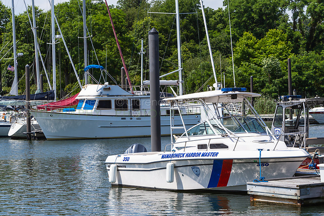 A Mamaroneck Harbor Master's boat docked in the West Basin of Mamaroneck Harbor in Harbor Island Park in Mamaroneck, New York.
