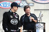 Nov. 13, 2011; Pomona, CA, USA; NHRA top fuel dragster driver Larry Dixon (left) and Del Worsham with the championship trophy during the Auto Club Finals at Auto Club Raceway at Pomona. Mandatory Credit: Mark J. Rebilas-.