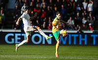 Jack Cork of Swansea City and Robbie Brady of Norwich City in action during the Barclays Premier League match between Swansea City and Norwich City played at The Liberty Stadium, Swansea on March 5th 2016