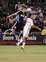 Eric Denton (left) heads the ball over Jovan Kirovski (9). San Jose Earthquakes tied Los Angeles Galaxy 1-1 at the McAfee Colisum in Oakland, California on April 18, 2009.