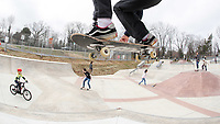 ANDREW SHURTLEFF/THE DAILY PROGRESS <br /> Sam Miller of Lynchburg launches over riders on opening day at the new Charlottesville skatepark. The grand opening will be held April 20th.
