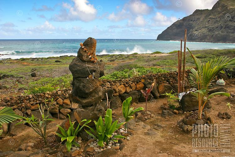 Sacred rocks with ti leaves and other plants along the Ka Iwi coastline along Kalaniana'ole Highway, near Makapu'u Beach and Lighthouse, O'ahu.