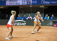 Arena Loire,  Trélazé,  France, 16 April, 2016, Semifinal FedCup, France-Netherlands, Doubles:   Hogenkamp  (L) Bertens (NED)<br /> Photo: Henk Koster/Tennisimages