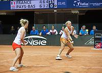 Arena Loire,  Trélazé,  France, 16 April, 2016, Semifinal FedCup, France-Netherlands, Doubles:   Hogenkamp  (L) Bertens (NED)<br /> Photo: Henk Koster/Tennisimages