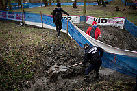 Until minutes before the start of the race, course volunteers were shovelling in an attempt to clear as much water from the swampy course as possible at the 2021 Flandriencross Hamme (BEL)<br /> <br /> ©kramon