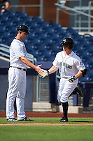 Peoria Javelinas manager Jared Sandberg (left) congratulates Tyler O'Neill (11), of the Seattle Mariners organization, after hitting a home run during a game against the Surprise Saguaros on October 12, 2016 at Peoria Stadium in Peoria, Arizona.  The game ended in a 7-7 tie after eleven innings.  (Mike Janes/Four Seam Images)