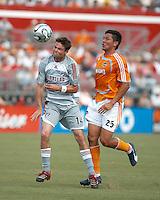 FC Dallas defender Drew Moor (14) heads the ball away from Houston Dynamo forward Brian Ching (25).  Houston Dynamo beat FC Dallas 2-1 at Robertson Stadium in Houston, TX on June 3, 2007.