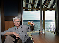 Al Lower holds up a glass of Johnnie Walker Red, the first alcoholic drink served on opening day at Hoover Grill  in Westerville, Ohio, Wednesday, Feb. 1, 2006. The restaurant on the banks of Hoover Reservoir is one of several new alcohol sales permits in the city, home to the Anti-Saloon League. Alcohol was last served in the city more than 120 years ago.<br />