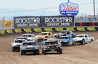Nov. 6, 2010; Las Vegas, NV USA; LOORRS pro four unlimited drivers Kyle Leduc (right) and Mike Johnson lead the field to the green flag during round 13 at the Las Vegas Motor Speedway short course. Mandatory Credit: Mark J. Rebilas-US PRESSWIRE