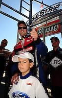 Oct. 30, 2011; Las Vegas, NV, USA: NHRA funny car driver Bob Tasca III with his son during the Big O Tires Nationals at The Strip at Las Vegas Motor Speedway. Mandatory Credit: Mark J. Rebilas-