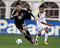 Santino Quaranta (25) of D.C. United moves from Juninho (19) of the Los Angeles Galaxy during an MLS match at RFK Stadium, on April 9 2011, in Washington D.C.The game ended in a 1-1 tie.