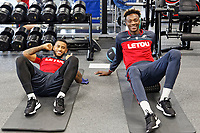 (L-R) Luciano Narsingh and Tammy Abraham exercise in the gym during the Swansea City Training and Press Conference at The Fairwood Training Ground, Swansea, Wales, UK. Thursday 25 January 2018