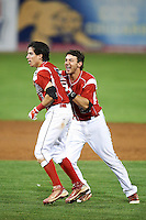 Batavia Muckdogs Garrett Wittels #21 (right) celebrates with Steve Ramos #5 after Ramos game winning hit during a NY-Penn League game against the Mahoning Valley Scrappers at Dwyer Stadium on August 22, 2012 in Batavia, New York.  Batavia defeated Mahoning Valley 3-2.  (Mike Janes/Four Seam Images)