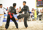 NGUYEN NGOC Toan (R) of Vietnam fights against SHUKOR Mohamad Zarish Hakim Shuk of Malaysia during the Pencak Silat Men's competition on Day Eight of the 5th Asian Beach Games 2016 at Bien Dong Park on 01 October 2016, in Danang, Vietnam. Photo by Marcio Machado / Power Sport Images