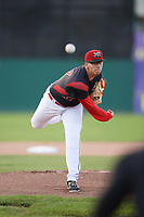 Batavia Muckdogs starting pitcher Alejandro Mateo (37) delivers a warmup pitch during a game against the West Virginia Black Bears on June 24, 2017 at Dwyer Stadium in Batavia, New York.  The game was suspended in the bottom of the third inning and completed on June 25th with West Virginia defeating Batavia 6-4.  (Mike Janes/Four Seam Images)