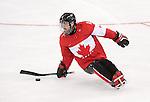 Sochi 2014 - Para Ice Hockey // Para-hockey sur glace. <br /> Team Canada takes on Sweden in Para Ice Hockey // Équipe Canada affronte la Suède en para-hockey sur glace. 08/03/2014.