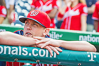 22 September 2013: Washington Nationals pitcher Drew Storen watches the video tribute to Manager Davey Johnson prior to a game against the Miami Marlins at Nationals Park in Washington, DC. The Marlins defeated the Nationals 4-2 in the first game of their day/night double-header. Mandatory Credit: Ed Wolfstein Photo *** RAW (NEF) Image File Available ***