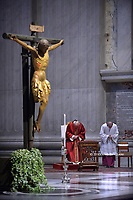 Pope Francis the ceremony of the Good Friday Passion of the Lord Mass in Saint Peter's Basilica at the Vatican.April 10, 2020.<br /> <br /> Miraculous crucifix of San Marcello Dating to the 15th century, the crucifix gained a miraculous reputation after surviving a fire in 1519 which burned the original church housing it to the ground. According to tradition, the morning after the fire the crucifix was found completely intact, and since then it has become a point of reference for those seeking special graces.<br /> <br /> In 1522, the crucifix was carried in procession throughout Rome for 16 days in the midst of a massive plague outbreak.
