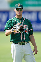 Kyle Jensen #22 of the Greensboro Grasshoppers warms up in the outfield prior to the South Atlantic League game against the Hickory Crawdads at  L.P. Frans Stadium July 10, 2010, in Hickory, North Carolina.  Photo by Brian Westerholt / Four Seam Images