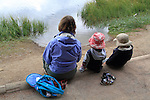 Caucasian mother and children taking a rest along Sprague Lake in Rocky Mountain National Park, Estes Park, Colorado