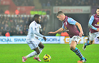 Pictured: Friday 26 December 2014<br /> Re: Premier League, Swansea City FC v Aston Villa at the Liberty Stadium, Swansea, south Wales, UK.<br /> <br /> Swansea's Nathan Dyer on the ball
