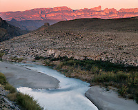 Sunset light on the Sierra del Carmen in Mexico and the Rio Grande River viewed from Hot Springs; Big Bend National Park; TX