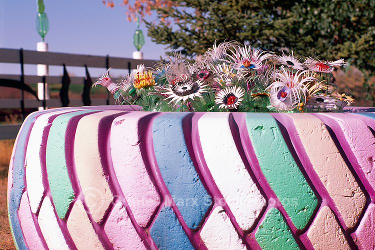 Large Truck Tire painted and recycled for reuse as a Flower Pot