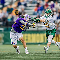 6 April 2019:  University at Albany Great Dane Midfielder Peter Schwab, a Sophomore from Penfield, NY, scores Albany's third goal as University of Vermont Catamount Midfielder Mark Marciano, a Senior from Searingtown, NY, is unable to strop the shot during game action at Virtue Field in Burlington, Vermont. The Cats rallied to defeat the Danes 10-9 in America East divisional play. Mandatory Credit: Ed Wolfstein Photo *** RAW (NEF) Image File Available ***