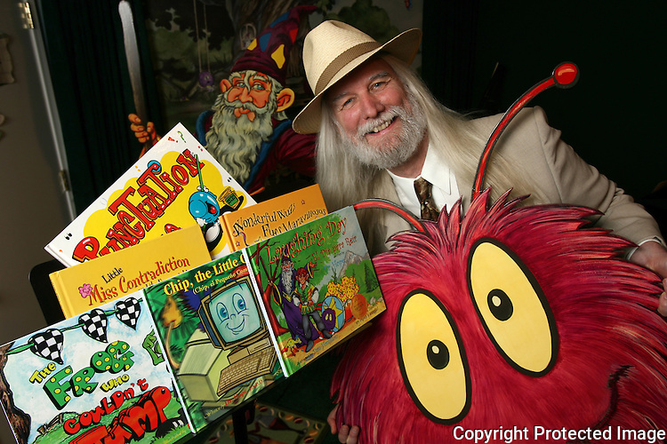 Children's book author Tim Anders shows off some of his books and book characters at his Fallbrook, California, home in May of 2009.  photo for the North County Times