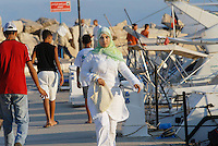 - Tunisia, young woman takes a walk in the tourist port of Sidi Bou Said<br />